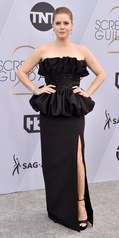Amy Adams showed some leg in a custom Celine gown , Cartier jewelry , and Jimmy Choo heels during the 2019 SAG Awards.