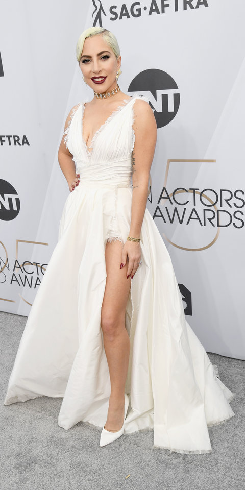 At the SAG Awards, Lady Gaga wowed in a haute couture Dior gown, Tiffany & Co. jewelry, and Jimmy Choo pumps ($516; farfetfch.com ).