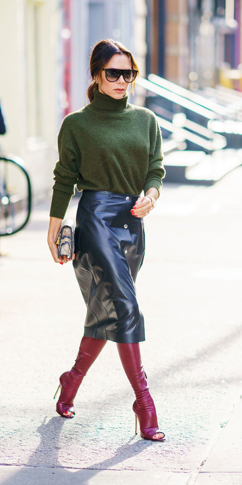 Victoria Beckham gave us a stylish lesson in winter dressing in a cozy green turtleneck , black leather skirt ($1,990; modaoperandi.com ), red over-the-knee boots, and a snakeskin bag.