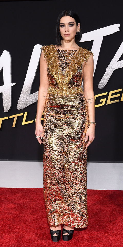 During the Alita: Battle Angel premiere, Dua Lipa smoldered in a glittery Prada gown and platform heels.