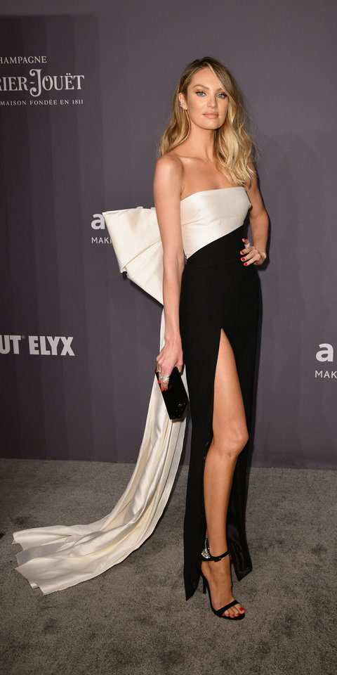 Candice Swanepoel took the bow trend to the next level in a Rasario gown with an oversized sash.