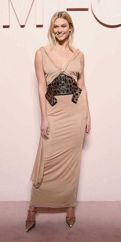 For Tom Ford's runway show, Karlie Kloss struck a pose in a beige Tom Ford dress with a wide leopard belt and double-strap pumps ($1,490; neimanmarcus.com ).