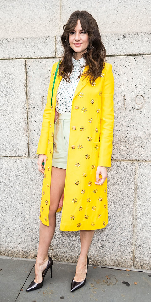 During NYFW, Shailene Woodley shined bright in a Carolina Herrera coat, a floral blouse, and mint green shorts.