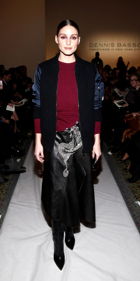 Olivia Palermo kept warm and stylish in a mixed fabric jacket, burgundy sweater, and a leather skirt during New York Fashion Week.