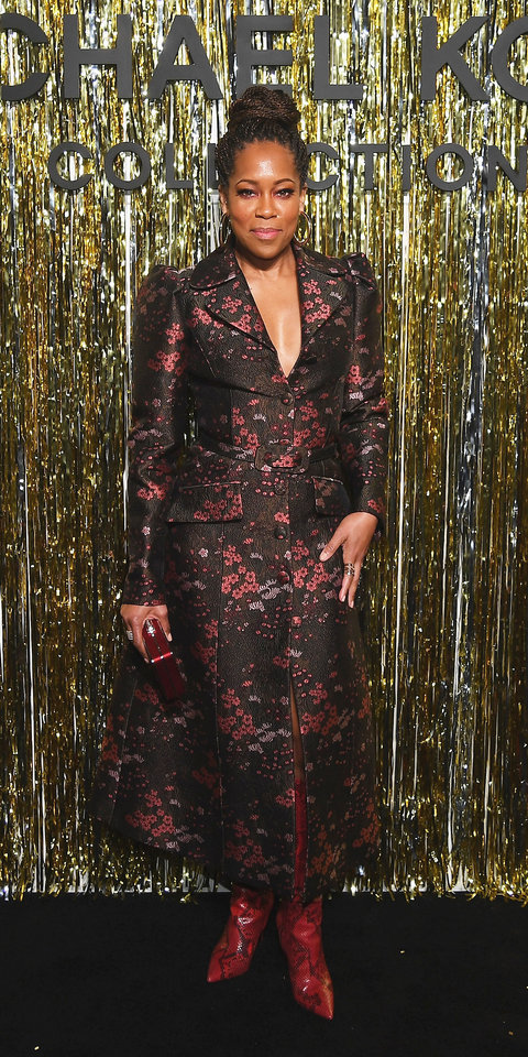 Regina King struck a pose at the Michael Kors show in a floral coat by the designer, python boots ($209; michaelkors.com ), and a red clutch.