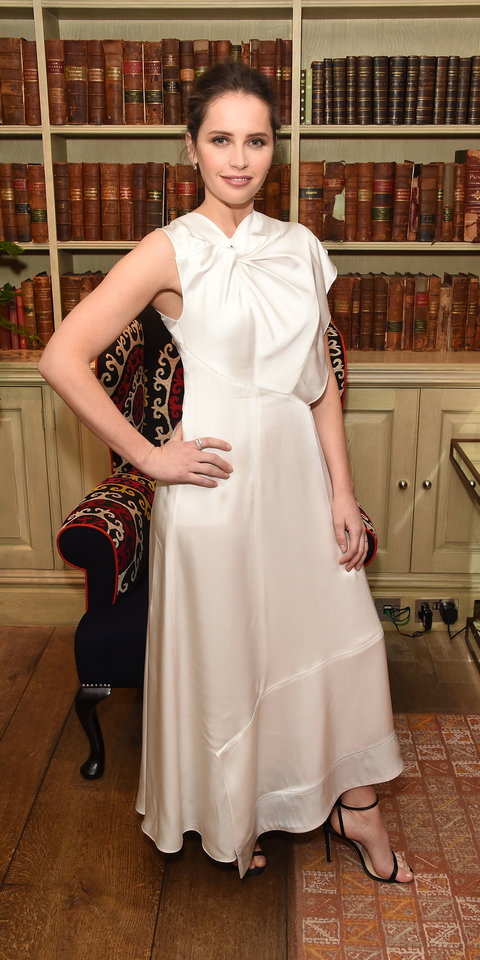 During a screening of On The Basis Of Sex , Felicity Jones posed for the cameras in a twist-knot dress and Jimmy Choo sandals ($750; jimmychoo.com ).