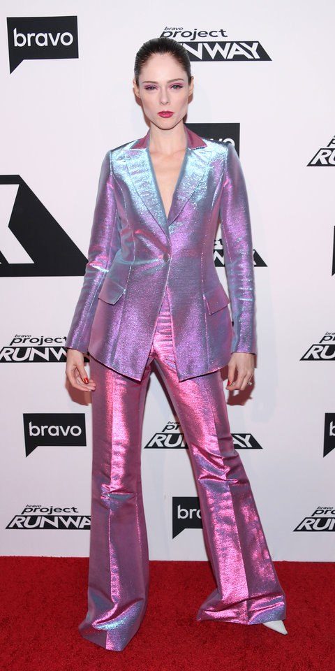 Coco Rocha lit up the red carpet in a prismatic suit by Christian Siriano for the premiere of the latest season of Project Runway .