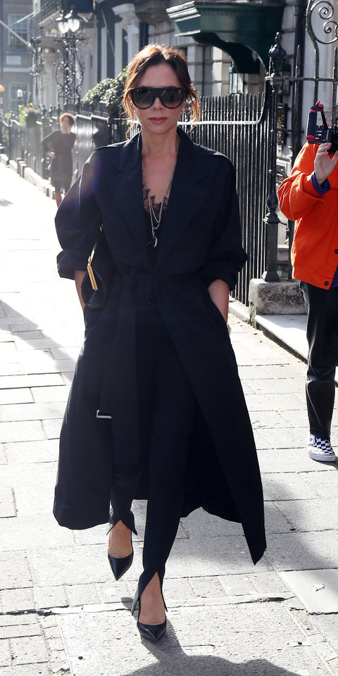 Victoria Beckham paired a lace camisole with a trench coat and split-front pants ($750; saks.com ) from her spring 2019 collection.