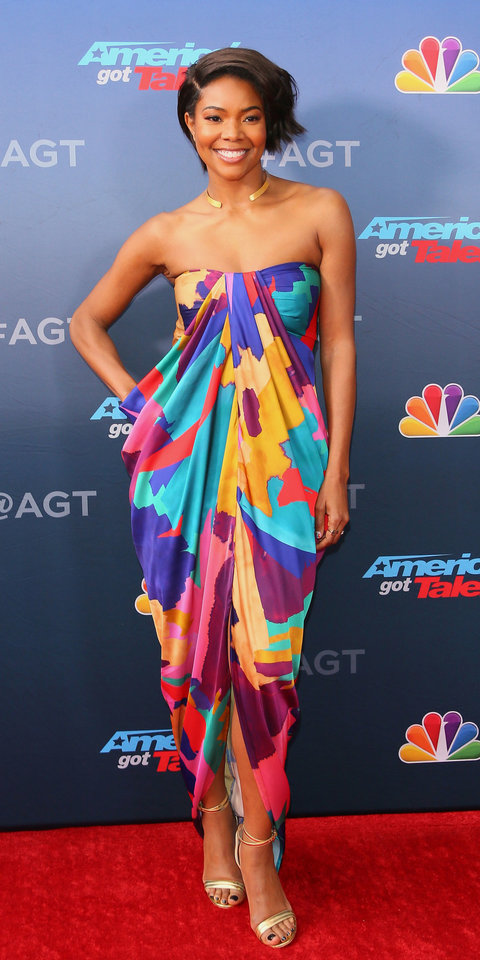 On the America's Got Talent red carpet, Gabrielle Union lit up the scene in a multi-color strapless dress with gold heels and a shiny choker.