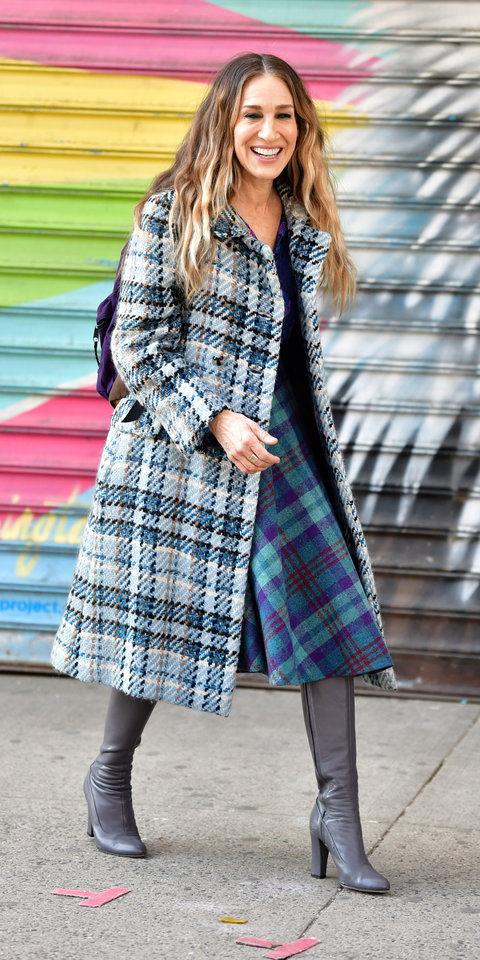 While filming Divorce , Sarah Jessica Parker mixed a plaid coat with a checkered dress and gray boots for a fun, polished outfit.