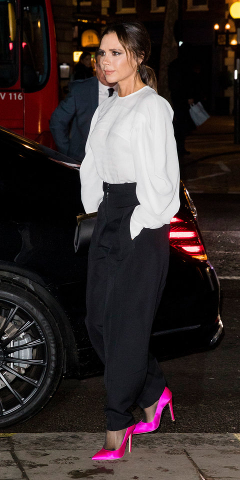 Victoria Beckham showed off a crisp white blouse, tailored trousers, and pink pumps from her Falll 2019 collection.