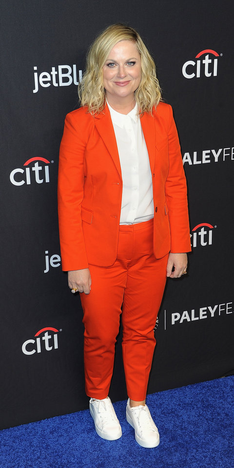 During the Parks and Rec panel at PaleyFest, Amy Poehler put a casual twist on an orange suit by pairing it with white sneakers.