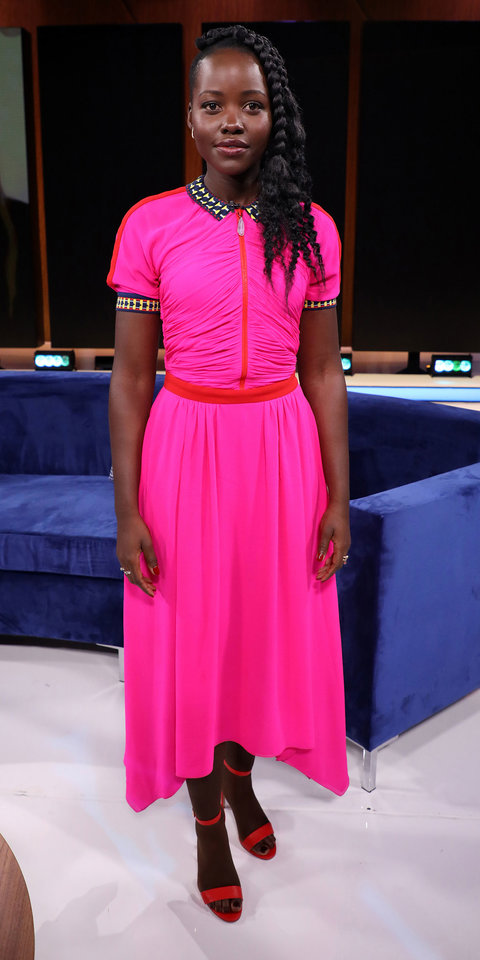 Lupita Nyong'o kept the neon colors coming with a hot pink Schiaparelli dress ($5,500; bergdorfgoodman.com ) and orange sandals while promoting her new film Us .
