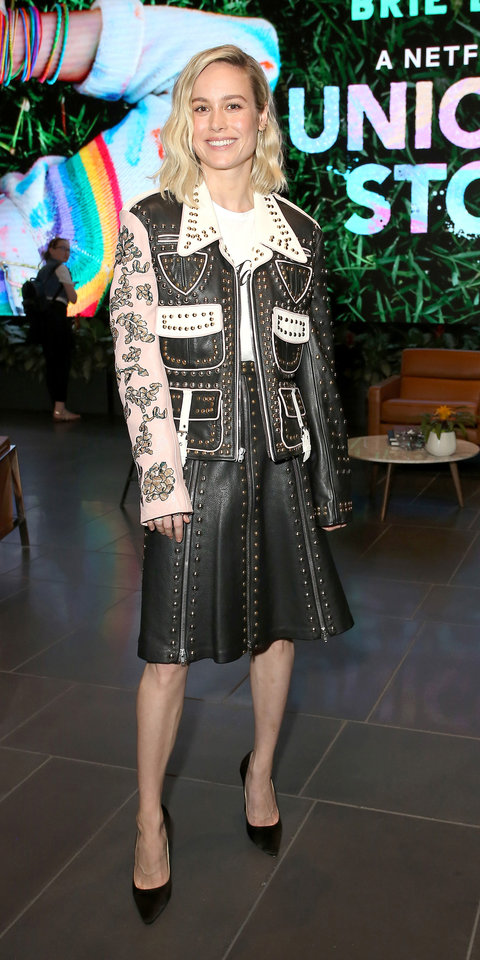 Brie Larson embraced the western vibes of a decorative Rodarte leather jacket, coordinating skirt, and Jimmy Choo pumps during a screening of Netflix's Unicorn Store .