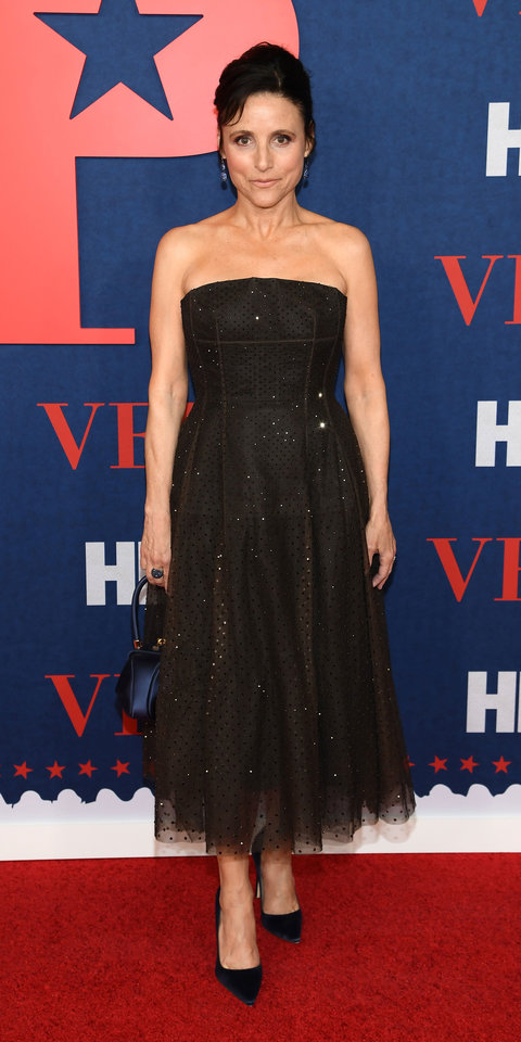 Julia Louis-Dreyfus stunned in a Marc Jacobs tulle dress, Manolo Blahnik navy pumps ($665; neimanmarcus.com ), Gabriela Hearst bag and, Nam Cho jewelry.