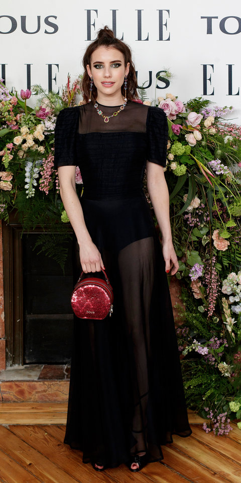 Emma Roberts chose a sheer dress, black sandals, and a Tous handbag and jewels while celebrating her partnership with the brand.
