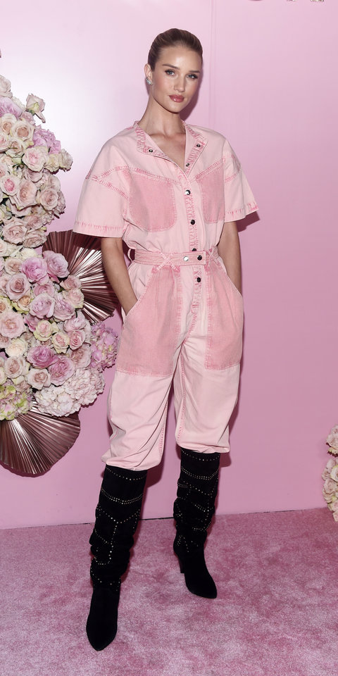 Rosie Huntington-Whiteley celebrated the launch of Patrick Ta's beauty collection in a pink Isabel Marant jumpsuit and suede boots ($2,440; matchesfashion.com ).