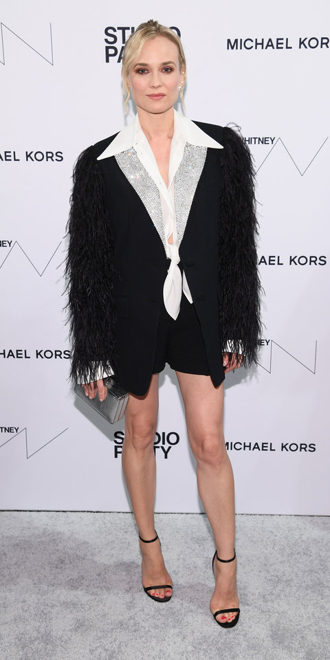 Diane Kruger made a cool statement in a short Michael Kors suit, which was accented with feathers and crystals.