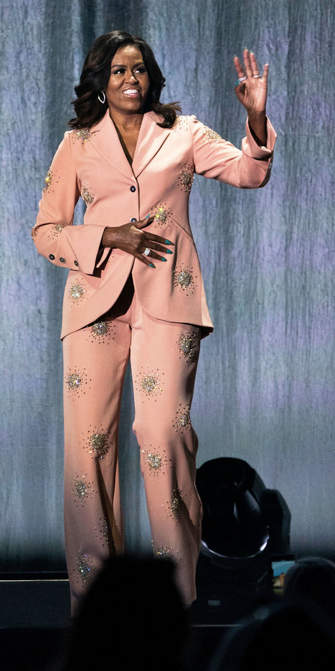 Michelle Obama looked absolutely stunning in a pink Stine Goya blazer ($1,335; net-a-porter.co m) and pants ($960; net-a-porter.com ) embellished with tiny crystals.
