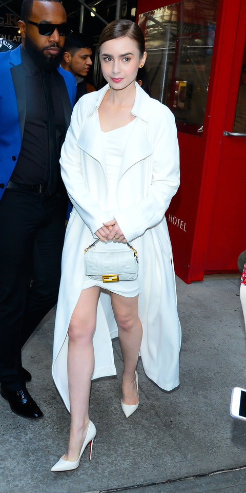 During an appearance on The Today Show , Lily Collins wore a white Ronny Kobo dress with a matching Kendall and Kylie jacket. Christian Louboutin heels ($695; net-a-porter.com ), a Fendi bag ($2,100; fendi.com ), and Cartier jewelry finished her look.