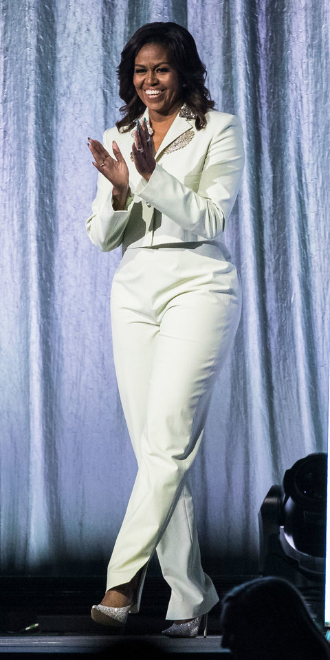 While promoting her book in Stockholm, Michelle Obama wore a white Acne Studios suit with glittery high heels.
