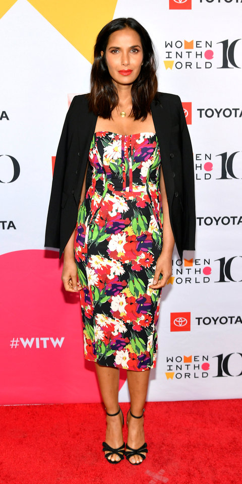 At the 10th Anniversary of the Women in the World Summit, Padma Lakshmi stepped out in a floral corset dress, a blazer draped over her shoulders, gold pendant necklace, and strappy sandals