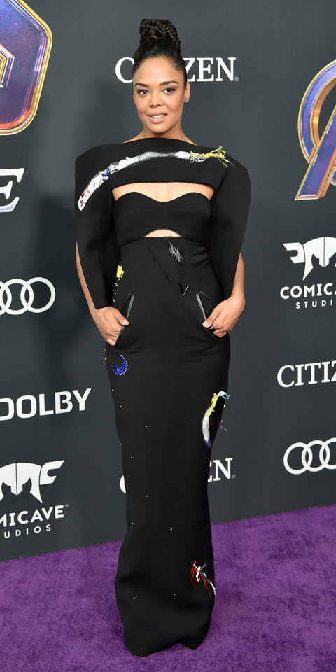 During the Avengers: Endgame premiere, Tessa Thompson made heads turn in a hand-painted Ronald van der Kemp gown with cool cutouts.