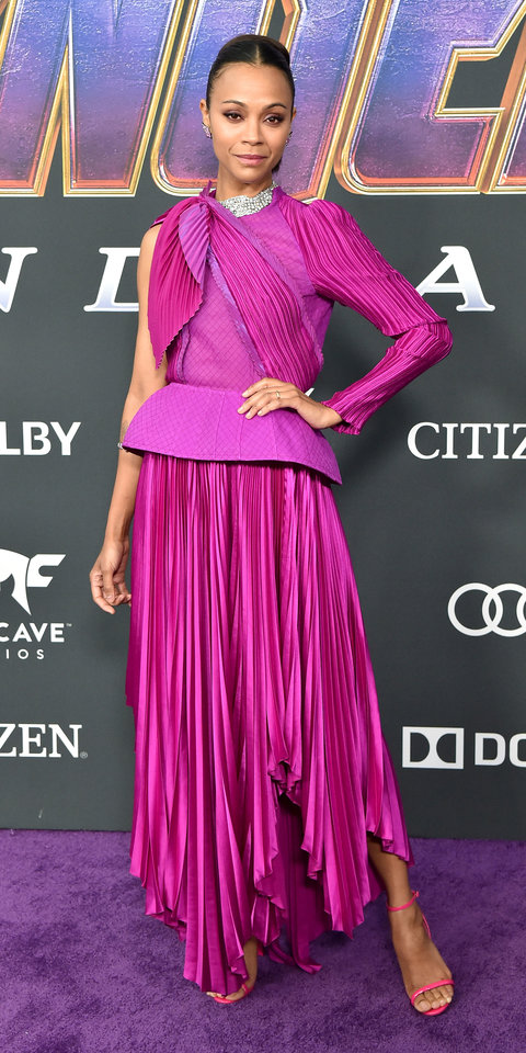 At the Avengers: Endgame premiere, Zoe Saldana brightened things up in a fuchsia Givenchy gown with a peplum waist and asymmetric pleating.