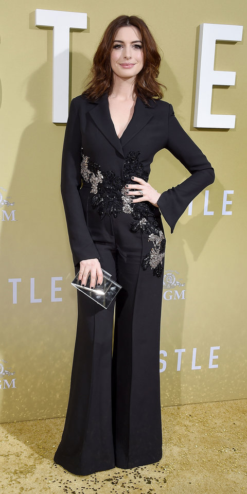 Anne Hathaway completely blew us away in a sequin-embroidered Elie Saab jumpsuit and a metallic clutch.