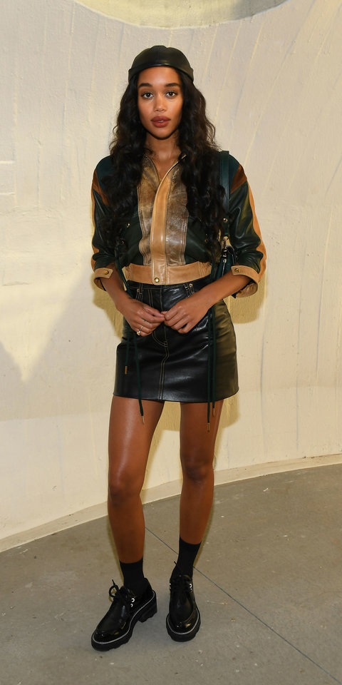 Laura Harrier made a casually cool statement at the Louis Vuitton Cruise 2020 show in a cropped leather jacket, leather mini skirt, lace-up brogues, and a leather cap.