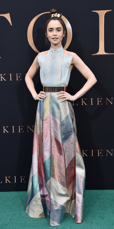 For a screening of Tolkien , Lily Collins wore a Ronald Van Der Kemp gown with a denim corset top and a multi-color striped skirt.
