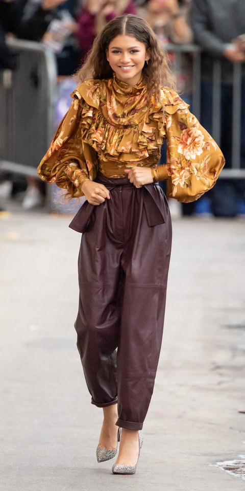 Zendaya hit the New York City streets in a floral ruffled blouse and leather trousers.