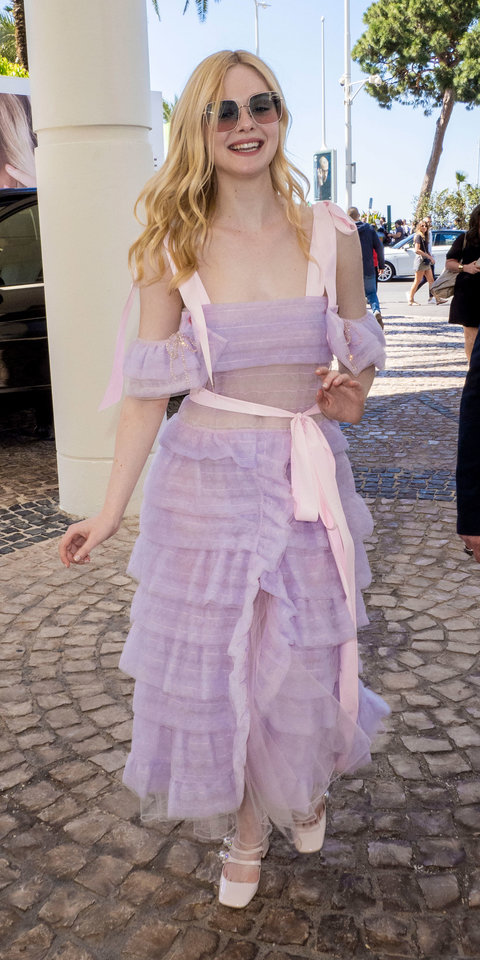 At the 72nd Annual Cannes Film Festival, Elle Fanning made a beautiful statement in a lilac tulle dress by Ryan Lo and Miu Miu Mary Jane pumps ($950; farfetch.com ).