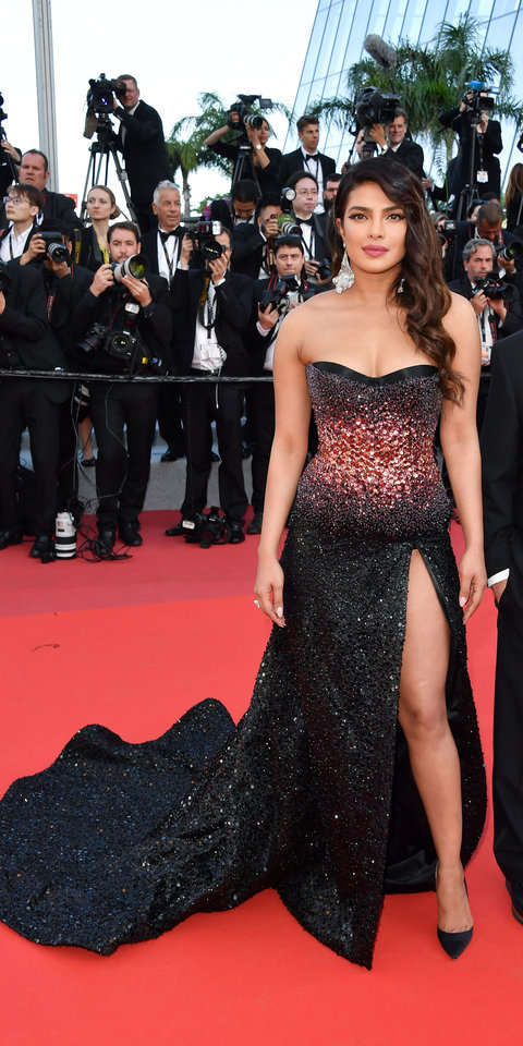 At the Cannes Film Festival, Priyanka Chopra wore a Roberto Cavalli Couture gradient gown, Christian Louboutin satin pumps ($725; net-a-porter.com ), and Chopard Jewelry.