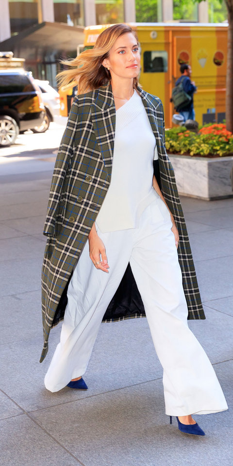 Allison Williams completely wowed in a Monse blouse, Ralph Lauren pants, a plaid coat by Alexa Chung , and Jimmy Choo heels.