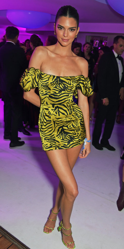 After debuting the Giambattista Valli x H&M collaboration , Kendall Jenner changed into a yellow animal print mini-dress for the amfAR Cannes Gala 2019 after party at Hotel du Cap-Eden-Roc.