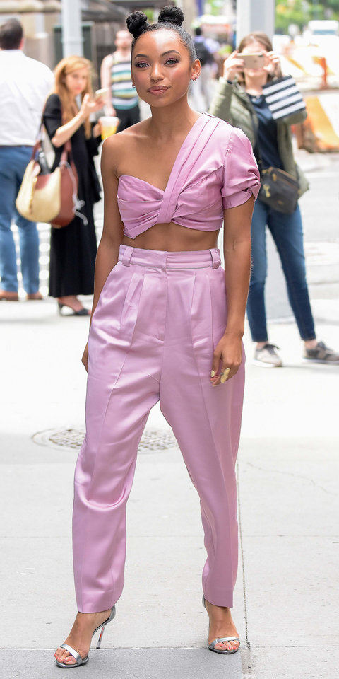 Logan Browning looked pretty in a pink in NYC while promoting Netflix's The Perfection .