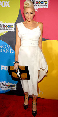 Gwen Stefani in Vivienne Westwood, carrying L.A.M.B.
