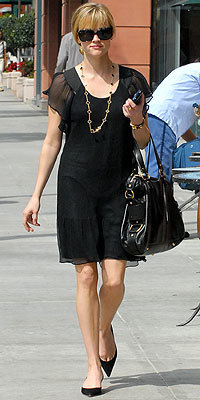 Reese Witherspoon carrying Yves Saint Laurent