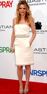 Michelle Pfeiffer in Jenni Kayne and Christian Louboutin, carrying Sergio Rossi