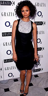Thandie Newton in Osman Yousefzada and Christian Louboutin, carrying Michael Teperson