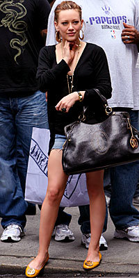 Hilary Duff in Tory Burch, carrying Cartier Marcello