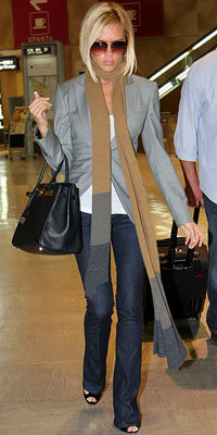 Victoria Beckham in Givenchy, carrying Birkin