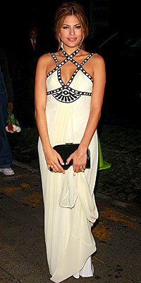 Eva Mendes in Temperley London and Christian Dior, carrying Brian Atwood