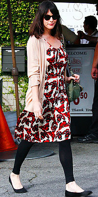 Liv Tyler in butterfly print dress and ballet flats and boyfriend cardigan