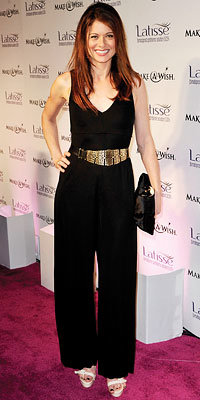 Debra Messing in Alice + Olivia carrying Jimmy Choo