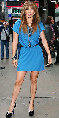 Jennifer Lopez in YSL shoes carrying Valentino