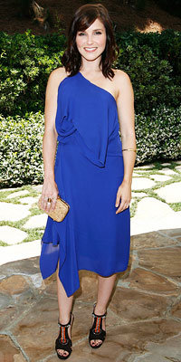Sophia Bush in Max Azria and Jimmy Choo, carrying Coach