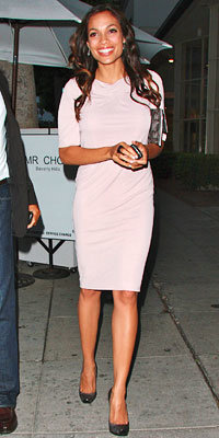 Rosario Dawson in RM by Roland Mouret, carrying a Jane Fonda clutch