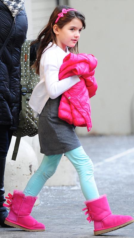 Suri Cruise wearing pink Uggs and teal tights